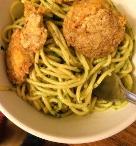 fried chicken of the woods with ramp pesto spaghetti